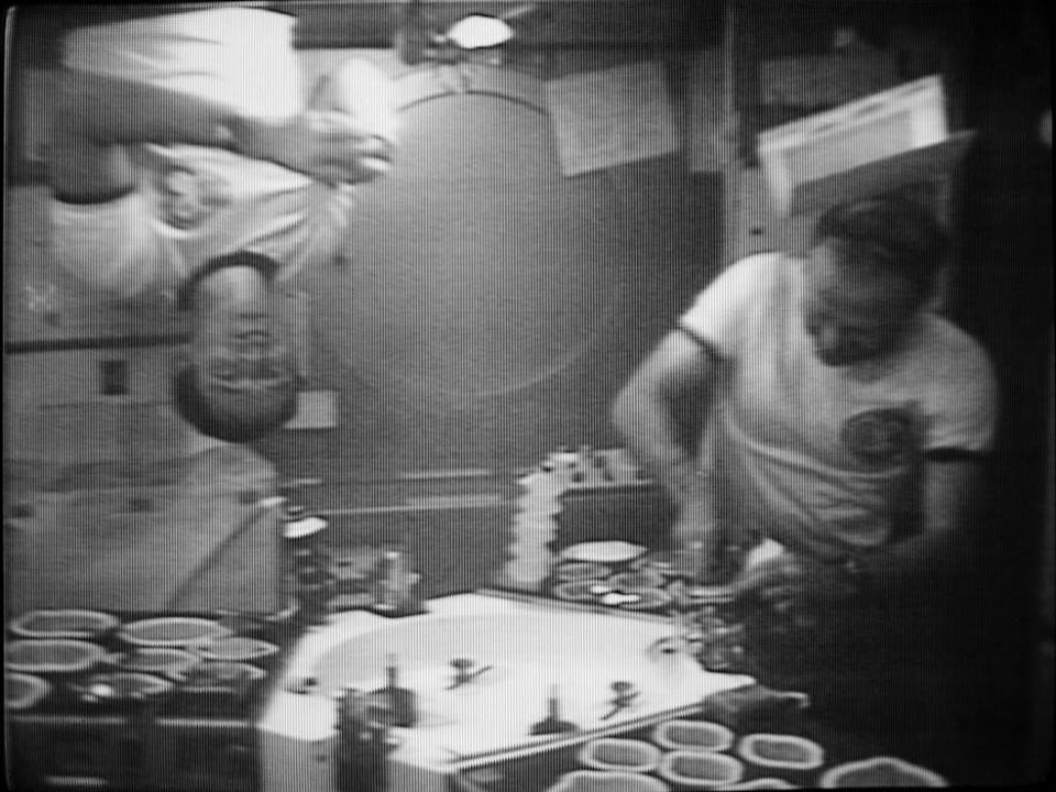 NASA's Skylab 4 astronauts Edward Gibson (left) and Gerald Carr dig in to their Thanksgiving meal aboard the U.S. space station Skylab during the Skylab 4 mission in 1973. It was the first Thanksgiving in space.