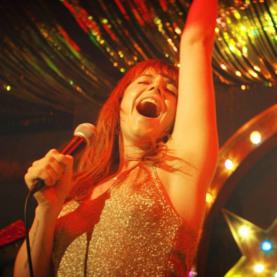 """<p>Jessie Buckley, who you may know from roles in <em>Judy, Beast,</em> or <em>Chernobyl</em>, scored the lead in <em>Wild Rose</em>, an underappreciated 2018 independent film about a Glaswegian single mom who dreams of becoming a Nashville star. And, yes, that is Buckley really singing. Flexing her twangy, velvety vocals, she helps shine a light on the underground country scene in Scotland (which even houses its own <a href=""""http://www.glasgowsgrandoleopry.co.uk/"""" rel=""""nofollow noopener"""" target=""""_blank"""" data-ylk=""""slk:Grand Ole Opry"""" class=""""link rapid-noclick-resp"""">Grand Ole Opry</a>). And though the entire soundtrack is worthy of playing on repeat, might we first direct your attention to Buckley's cover of Patty Griffin's """"<a href=""""https://www.youtube.com/watch?v=2IoqzC5exOk"""" rel=""""nofollow noopener"""" target=""""_blank"""" data-ylk=""""slk:Crying Over"""" class=""""link rapid-noclick-resp"""">Crying Over</a>"""" and her character's redemption song, """"<a href=""""https://www.youtube.com/watch?v=E-l-Ly0ly4M"""" rel=""""nofollow noopener"""" target=""""_blank"""" data-ylk=""""slk:Glasgow"""" class=""""link rapid-noclick-resp"""">Glasgow</a>,"""" written by Mary Steenburgen.</p><p><a class=""""link rapid-noclick-resp"""" href=""""https://www.amazon.com/Wild-Rose-Jessie-Buckley/dp/B07SQF41QF?tag=syn-yahoo-20&ascsubtag=%5Bartid%7C10056.g.32872244%5Bsrc%7Cyahoo-us"""" rel=""""nofollow noopener"""" target=""""_blank"""" data-ylk=""""slk:Watch and Listen"""">Watch and Listen</a></p>"""