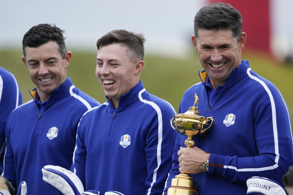 Team Europe captain Padraig Harrington, Team Europe's Matt Fitzpatrick and Team Europe's Rory McIlroy pose for a team photo during a practice day at the Ryder Cup at the Whistling Straits Golf Course Tuesday, Sept. 21, 2021, in Sheboygan, Wis. (AP Photo/Jeff Roberson)