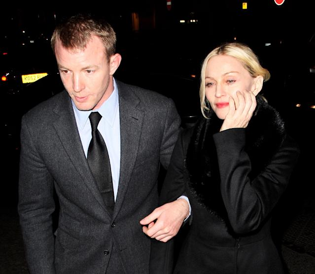 Madonna and Guy Ritchie arrive at Harry's in Mayfair, London, in 2008 (Getty)