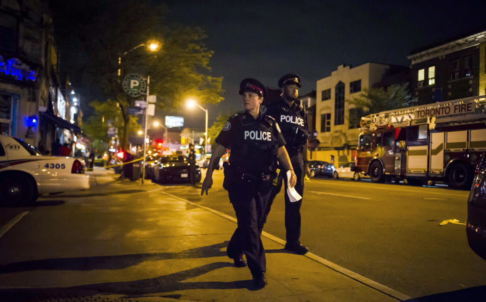 """<em><span class=""""s1"""">Witnesses say a man dressed in black fired up to 20 shots outside a restaurant</span> (AP)</em>"""