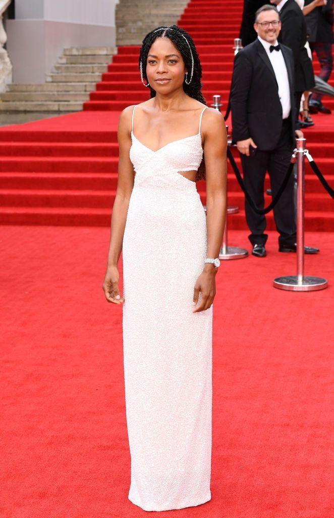 <p>Harris wore a white, cut-out, column dress by Michael Kors with an Omega watch.</p>