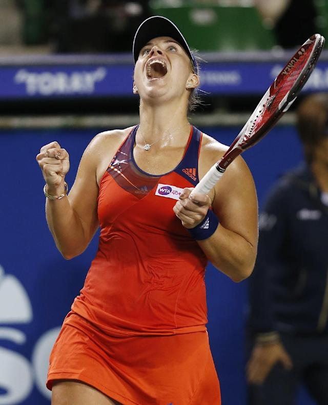 Angelique Kerber of Germany reacts after winning over Caroline Wozniacki of Denmark during their semi-final match of the Pan Pacific Open tennis tournament in Tokyo, Friday, Sept. 27, 2013. (AP Photo/Koji Sasahara)