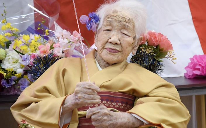 Kane Tanaka, born in 1903, celebrating her 117th birthday in 2020. She is the oldest living person - KYODO/REUTERS