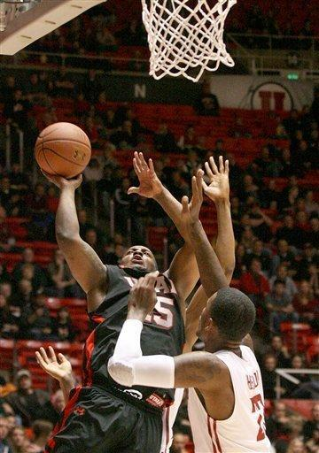 Utah's Josh Watkins, rear, drives to the basket as Washington State's D.J. Shelton defends during an NCAA college basketball game between Utah and Washington State, Thursday, Jan. 5, 2012, in Salt Lake City. (AP Photo/The Deseret News, Paul Fraughton) SALT LAKE TRIBUNE OUT; PROVO DAILY HERALD OUT; MAGS OUT