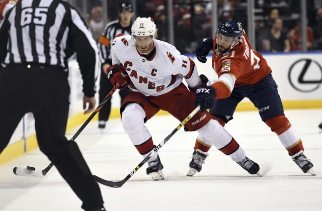 Carolina Hurricanes center Jordan Staal (11) battles for possession against Florida Panthers center Vincent Trocheck (21) during the second period of an NHL hockey game Tuesday, Oct. 8, 2019, in Sunrise, Fla. (AP Photo/Jim Rassol)