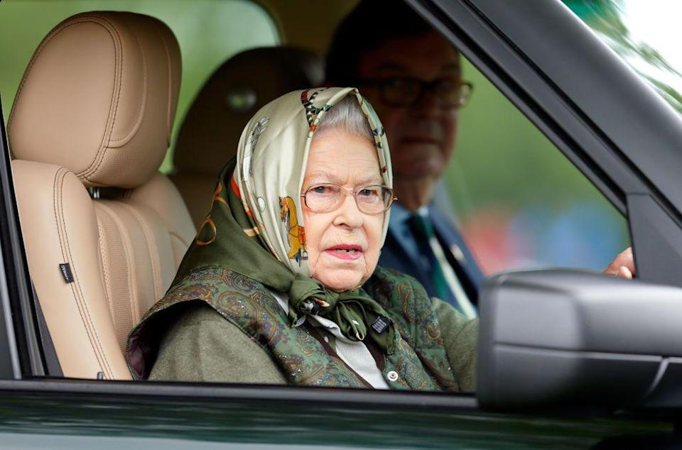 <p>Once again attending the Royal Windsor Horse Show, the Queen entered the event while driving her Range Rover. Fittingly, she chose a headscarf with a horse print. </p>