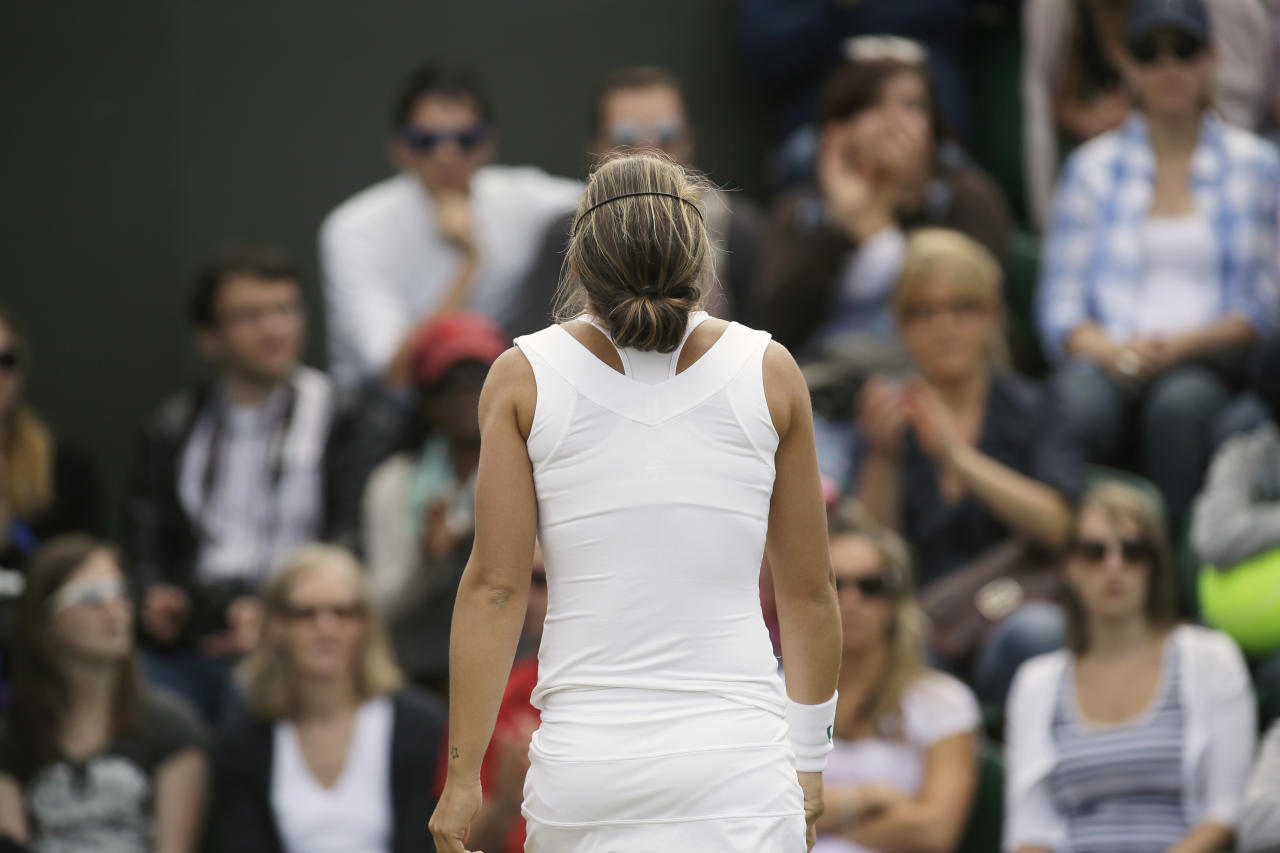 Sara Errani of Italy reacts during a third round women's singles against Yaroslava Shvedova of Kazakhstan during a third round women's singles match at the All England Lawn Tennis Championships at Wimbledon, England, Saturday, June 30, 2012. (AP Photo/Sang Tan)