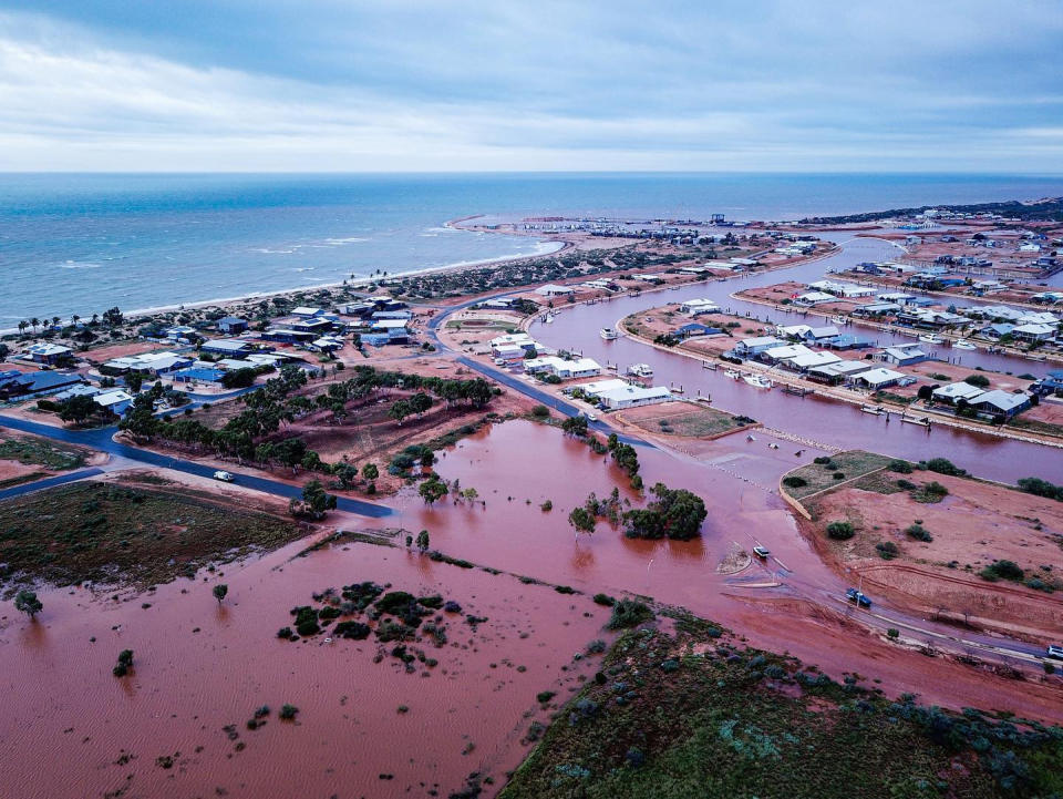 Floodwaters take over Exmouth after an unusually heavy downpour.