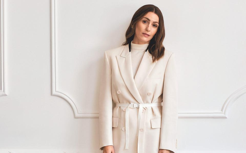 Suranne wears jacket, £1,295, Stella McCartney; top, £25, Cos; trousers, £350, Raey; shoes, £605, Aquazzura; earrings, £475, Susan Caplan; 18ct-yellow-gold ring, £4,500, and 18ct-yellow-gold and diamond ring, £4,000, both Minka - Philip Sinden