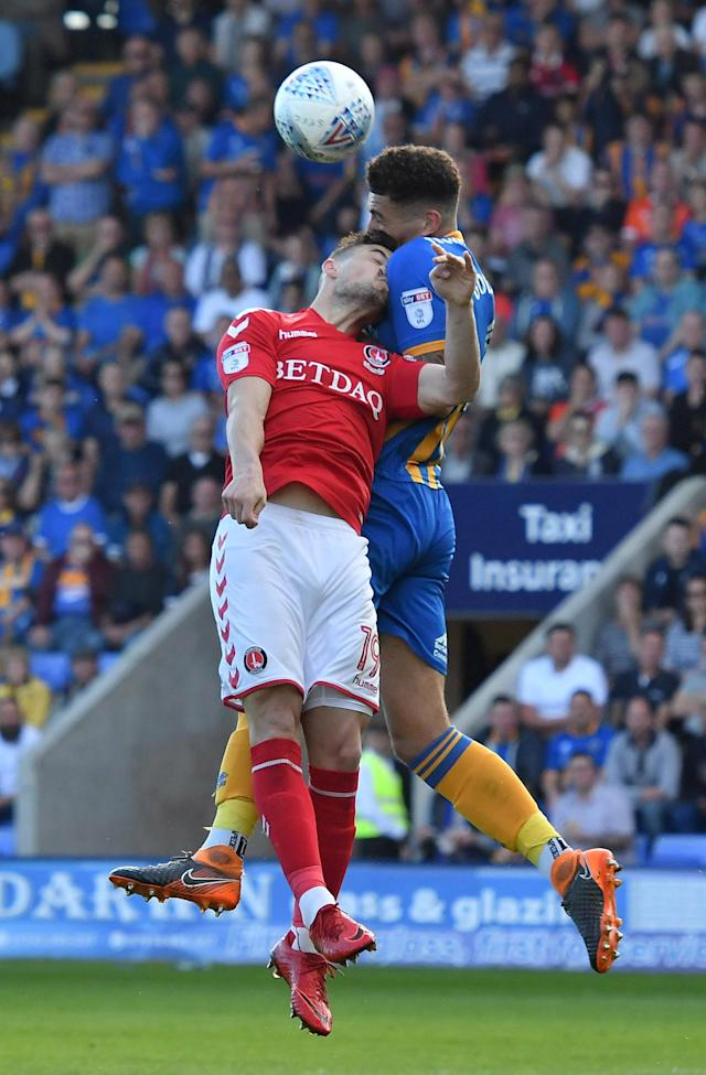 "Soccer Football - League One Play Off Semi Final Second Leg - Shrewsbury Town vs Charlton Athletic - Montgomery Waters Meadow, Shrewsbury, Britain - May 13, 2018 Charlton Athletic's Jake Forster-Caskey in action with Shrewsbury Town's Ben Godfrey Action Images/Paul Burrows EDITORIAL USE ONLY. No use with unauthorized audio, video, data, fixture lists, club/league logos or ""live"" services. Online in-match use limited to 75 images, no video emulation. No use in betting, games or single club/league/player publications. Please contact your account representative for further details."