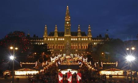 The city hall is pictured behind Christkindlmarkt advent market in Vienna