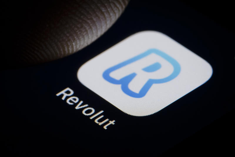 BERLIN, GERMANY - JANUARY 11: In this photo illustration the Logo of british online bank Revolut is displayed on a smartphone on January 11, 2019 in Berlin, Germany. (Photo Illustration by Thomas Trutschel/Photothek via Getty Images)