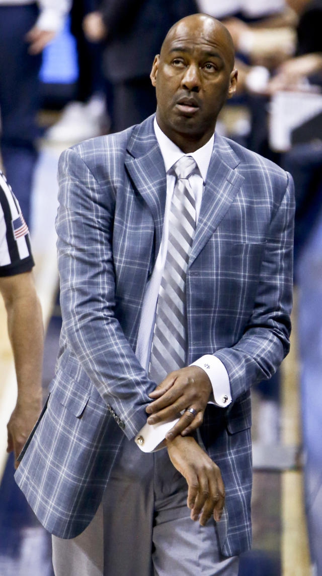 Wake Forest coach Danny Manning looks up at the scoreboard as his team plays Pittsburgh during the second half of an NCAA college basketball game Wednesday, Feb. 21, 2018, in Pittsburgh. Wake Forest won 63-57. (AP Photo/Keith Srakocic)