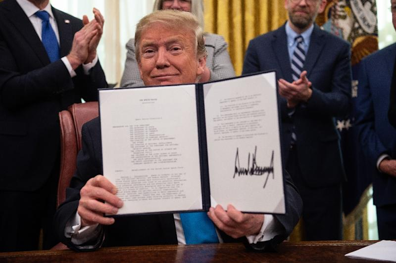 US President Donald Trump shows his signature on the Space Policy Directive-4 (SPD-4) on February 19, 2019 at the White House -- he directed the US Defense Department to establish a Space Force as the sixth branch of the Armed Forces