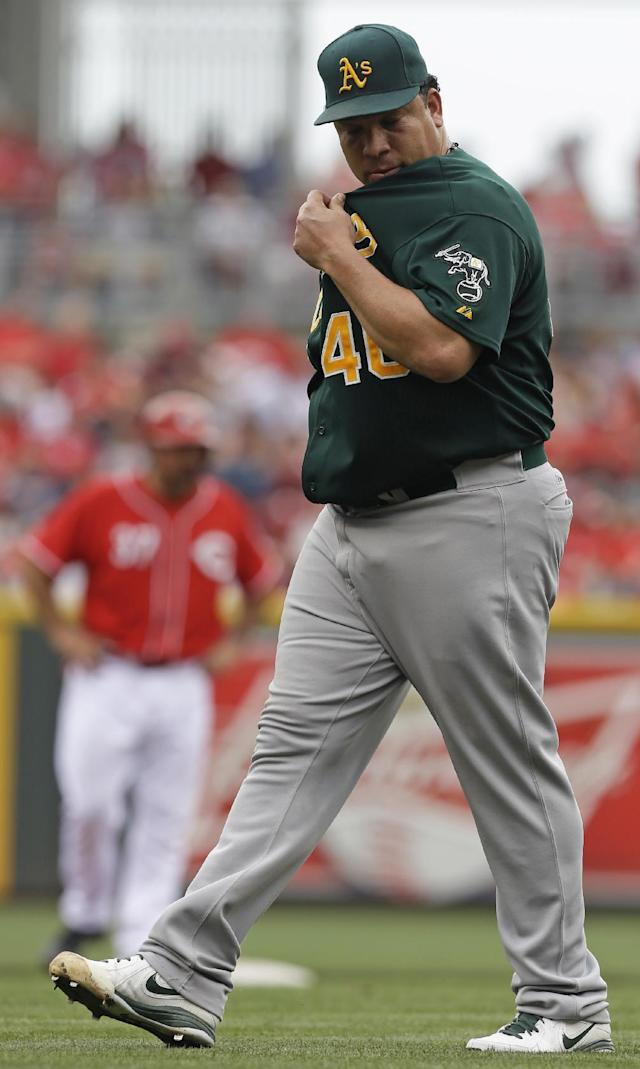 Oakland Athletics starting pitcher Bartolo Colon walks to the dugout after being taken out in the third inning of a baseball game against the Cincinnati Reds, Wednesday, Aug. 7, 2013, in Cincinnati. (AP Photo/Al Behrman)