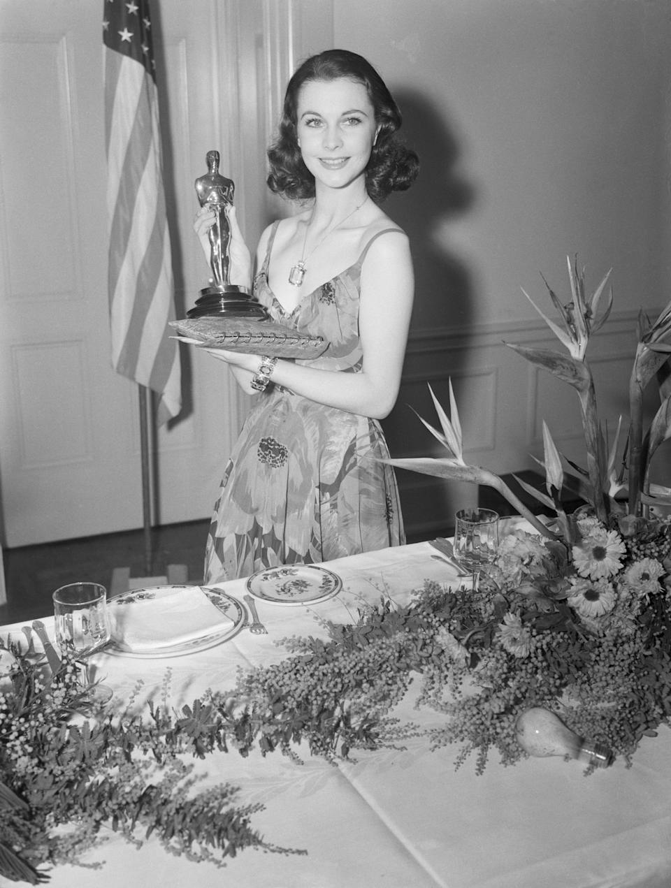 When Vivien Leigh collected her Best Actress statuette in 1940, she did it in true old Hollywood fashion. Dressed in a custom dress by Irene Lentz Gibbons, MGM's costume supervisor whose private salon at legendary Wilshire Boulevard department store, Bullocks, was a favorite of the era's stars, Leigh accessorized with a good luck charm from then-husband Laurence Olivier. Her Van Cleef & Arpel's aquamarine pendant had been a gift from Olivier after she'd wrapped production on <em>Gone with the Wind.</em> Though it could also be worn as a brooch, Leigh kept the oversized statement piece on a long gold chain during the ceremony.