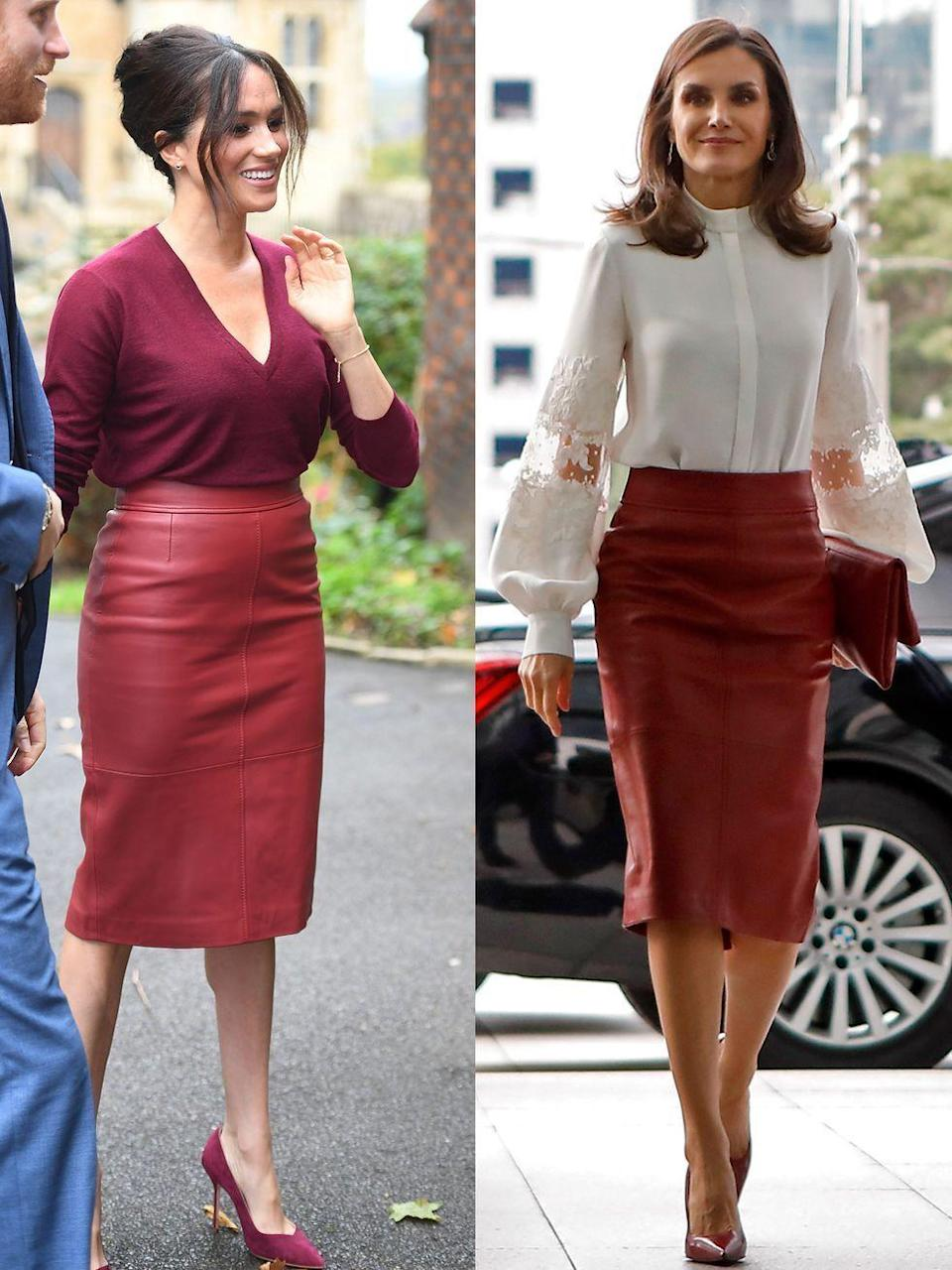 <p><strong>Left: </strong>On October 24, 2019, Meghan, Duchess of Sussex attended a roundtable discussion about gender equality as part of the One Young World summit, wearing a chic red leather Hugo Boss pencil skirt with a burgundy v-neck sweater.</p><p><strong>Right: </strong>On the same day, Queen Letizia of Spain twinned with the Duchess for a meeting in Seoul, only she paired the skirt with a crisp white blouse.</p>