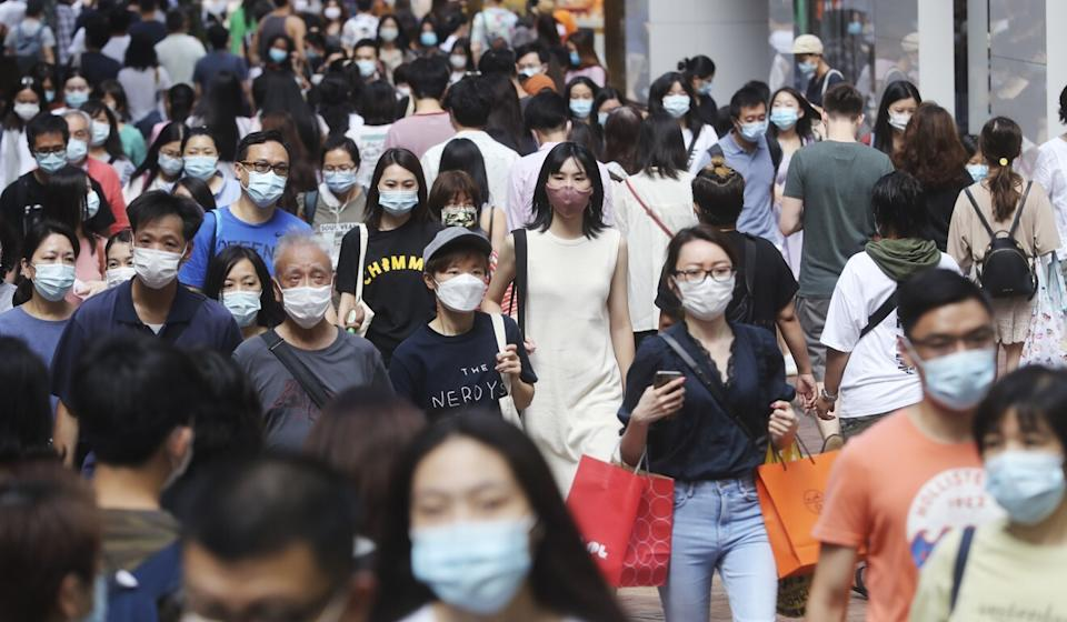 Shoppers crowd Causeway Bay in downtown Hong Kong. The government has bought the most number of flu vaccines in four years but even that might not be enough. Photo: Edmond So
