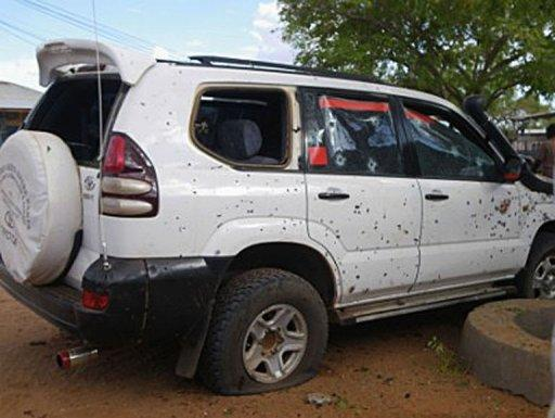 A car punctured with bullet holes is pictured after a suicide bomber blew himself up