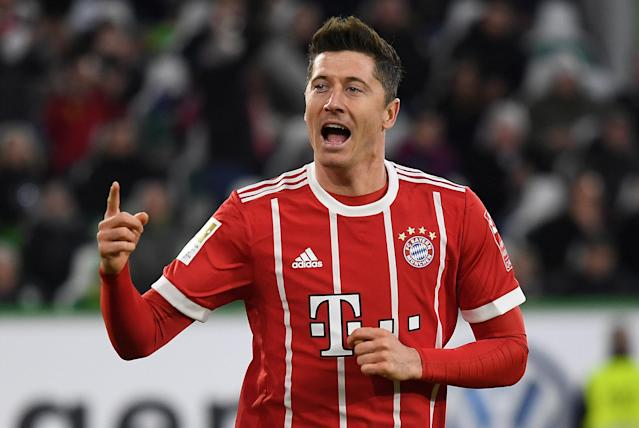 Soccer Football - Bundesliga - VfL Wolfsburg vs Bayern Munich - Volkswagen Arena, Wolfsburg, Germany - February 17, 2018 Bayern Munich's Robert Lewandowski celebrates scoring their second goal REUTERS/Fabian Bimmer DFL RULES TO LIMIT THE ONLINE USAGE DURING MATCH TIME TO 15 PICTURES PER GAME. IMAGE SEQUENCES TO SIMULATE VIDEO IS NOT ALLOWED AT ANY TIME. FOR FURTHER QUERIES PLEASE CONTACT DFL DIRECTLY AT + 49 69 650050