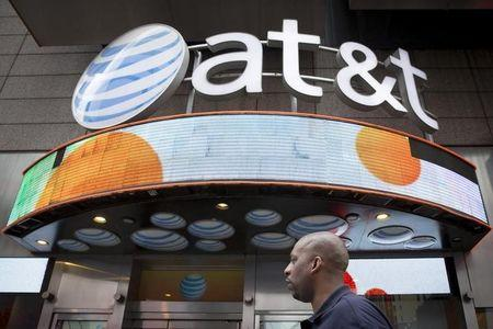 A man walks past the AT&T store in New York's Times Square