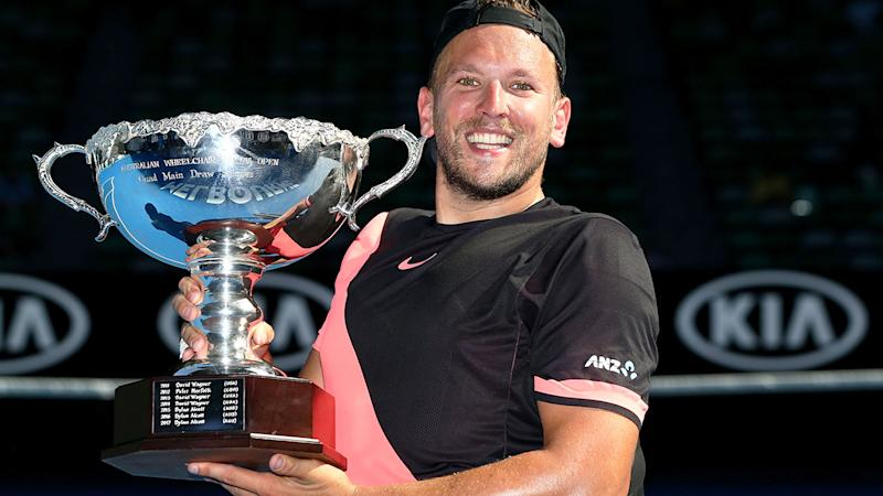 Pictured here, Dylan Alcott with his 2018 Australian Open trophy.