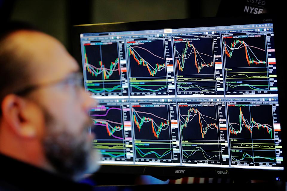 A trader works on the floor of the New York Stock Exchange shortly after the opening bell in New York City, U.S., November 21, 2019.  REUTERS/Lucas Jackson