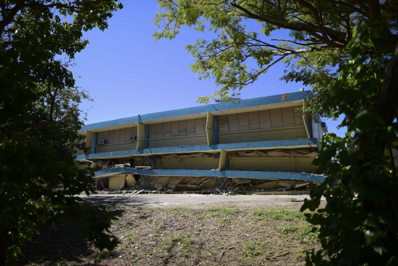 The Adripina Seda public school stands partially collapsed after an earthquake struck Guanica, Puerto Rico, Tuesday, Jan. 7, 2020. A 6.4-magnitude earthquake struck Puerto Rico before dawn on Tuesday, killing one man, injuring others and collapsing buildings in the southern part of the island. (AP Photo/Carlos Giusti)
