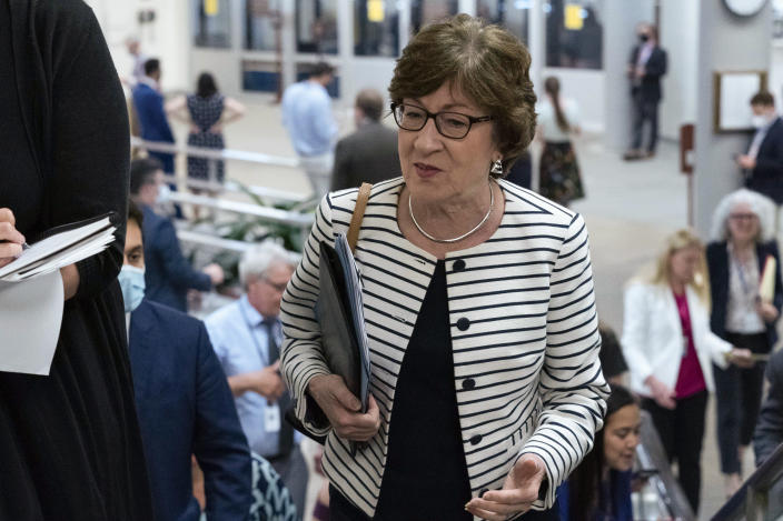 Sen. Susan Collins, R-Maine, talks to reporters as she walks to the Senate chamber ahead of a test vote scheduled by Democratic Leader Chuck Schumer of New York on the bipartisan infrastructure deal senators brokered with President Joe Biden, on Capitol Hill, in Washington, Wednesday, July 21, 2021. Republicans prepared to block the vote by mounting a filibuster over what they see as a rushed and misguided process. (AP Photo/Jose Luis Magana)