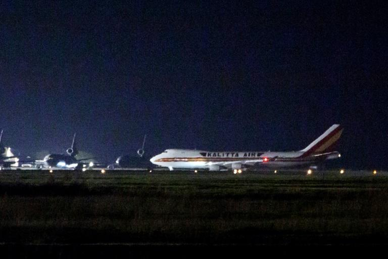 A plane carrying American passengers, who were released from the Diamond Princess cruise ship in Japan, arrives at Travis Air Force Base in California on February 16