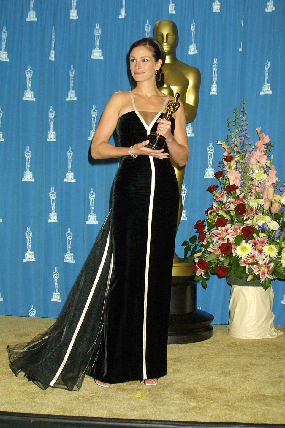 <p>The actress was all elegance in this vintage black-and-white Valentino dress and pinned-up 'do. Her stellar performance in <em>Erin Brockovich </em>earned her the Best Actress award for the night. </p>