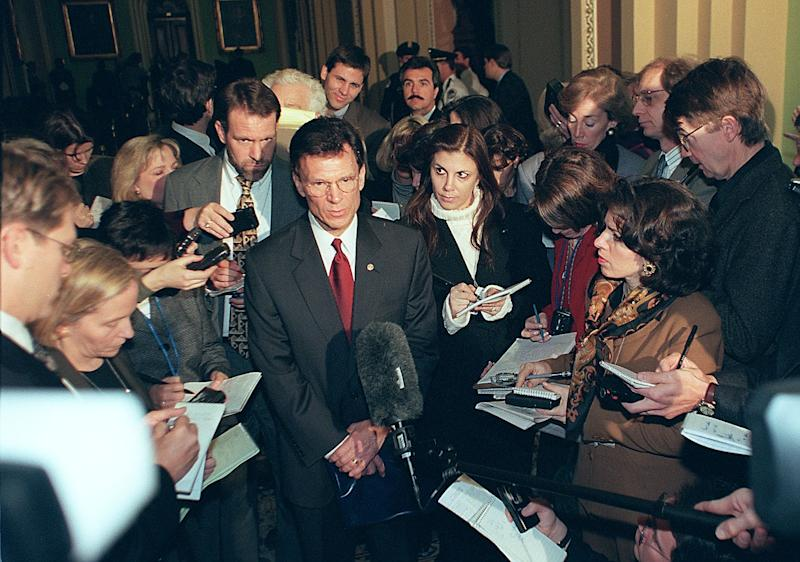 Senate Minority Leader Tom Daschle, (C), D-SD, speaks to reporters after meetings on Capitol Hill in Washington, DC 06 January. Daschle met with other senate members to determine how the impeachment trial of US President Bill Clinton should be conducted. (Photo: William Philpott/AFP via Getty Images)