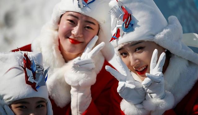 Biathlon - Pyeongchang 2018 Winter Paralympics - Alpensia Biathlon Centre - Pyeongchang, South Korea - March 13, 2018 - Medal host girls pose for pictures. REUTERS/Carl Recine