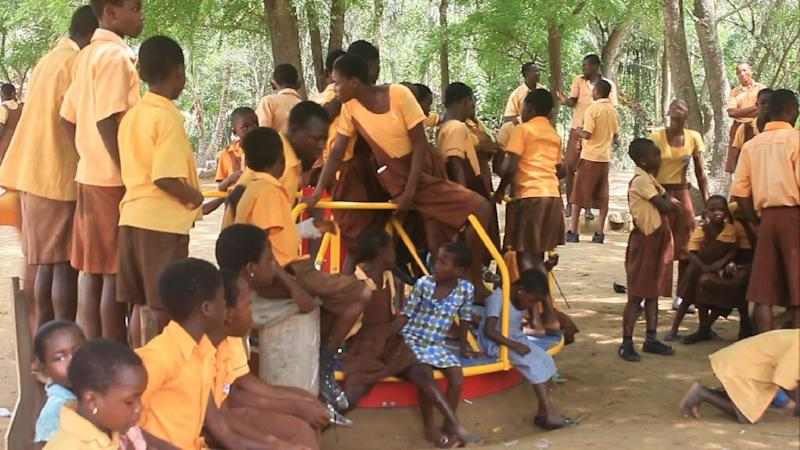 A school on Ghana's Volta River uses the natural energy of children to generate electricity every time they use specially adapted roundabouts