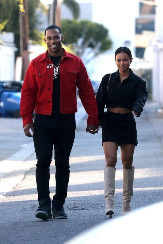 <p>New-couple alert! Chris Brown's ex and the former NFL wide receiver confirmed rumors they are a thing on Saturday, when they were spotted holding hands while lunching in Hollywood. Whispers that the two are romantically involved began last month, when they were seen catching a movie together over the Thanksgiving holiday. (Photo: Backgrid) </p>