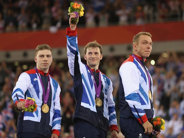 LONDON, ENGLAND - AUGUST 02: (L-R) Philip Hindes, Jason Kenny and Sir Chris Hoy of Great Britain celebrate with their gold medals during the medal ceremony after setting a new world record in the Men's Team Sprint Track Cycling final on Day 6 of the London 2012 Olympic Games at Velodrome on August 2, 2012 in London, England. (Photo by Bryn Lennon/Getty Images)