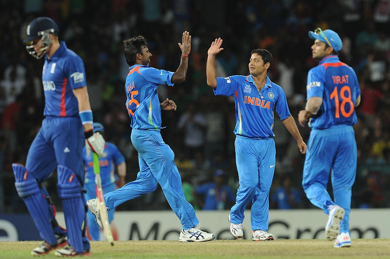 Indian spinner Piyush Chawla (2R) celebrates with his teammates after he dismissed England cricketer Jonathan Bairstow (L) during the ICC Twenty20 Cricket World Cup match between England and Indian at the R. Premadasa Stadium in Colombo on September 23, 2012. AFP PHOTO/ LAKRUWAN WANNIARACHCHILAKRUWAN WANNIARACHCHI/AFP/GettyImages
