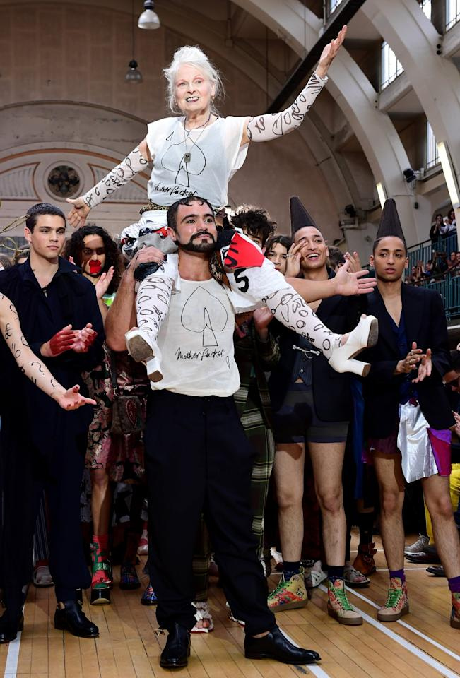 <p>Vivienne Westwood rides a model's shoulders during her SS18 show.<br /><i>[Photo: PA]</i> </p>