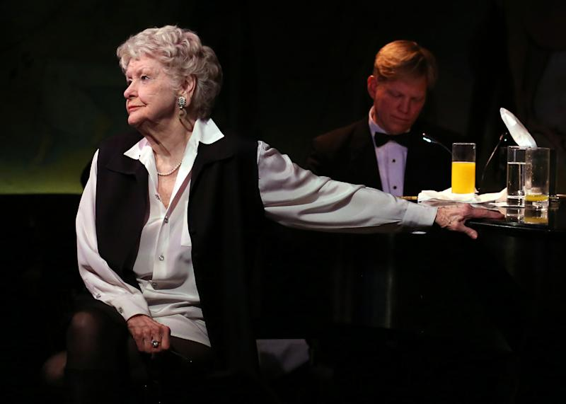 This April 2, 2013 image released by the O+M Company shows Elaine Stritch performing her final engagement at the Cafe Carlyle in New York with Rob Bowman at the piano. Stritch kicked off a final series of concerts to bid farewell to New York on Tuesday, refusing to be maudlin and instead weaving her typical brand of sass and feistiness. Stritch plans to retire to Birmingham, Mich. a suburb of Detroit, after seven decades in New York City. She ends her five-show farewell on Saturday. (AP Photo/The O+M Company, Walter McBride)