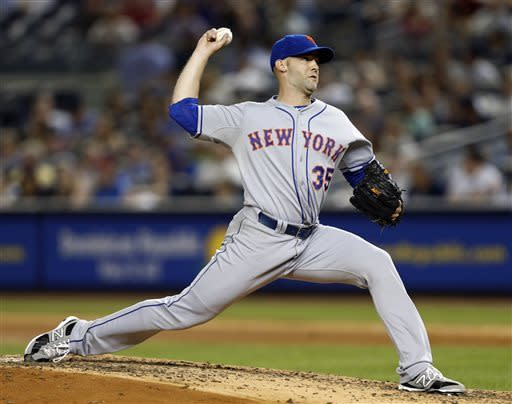 New York Mets starting pitcher Dillon Gee (35) winds up in the seventh inning of an interleague baseball game against the New York Yankees at Yankee Stadium in New York, Thursday, May 30, 2013. (AP Photo/Kathy Willens)