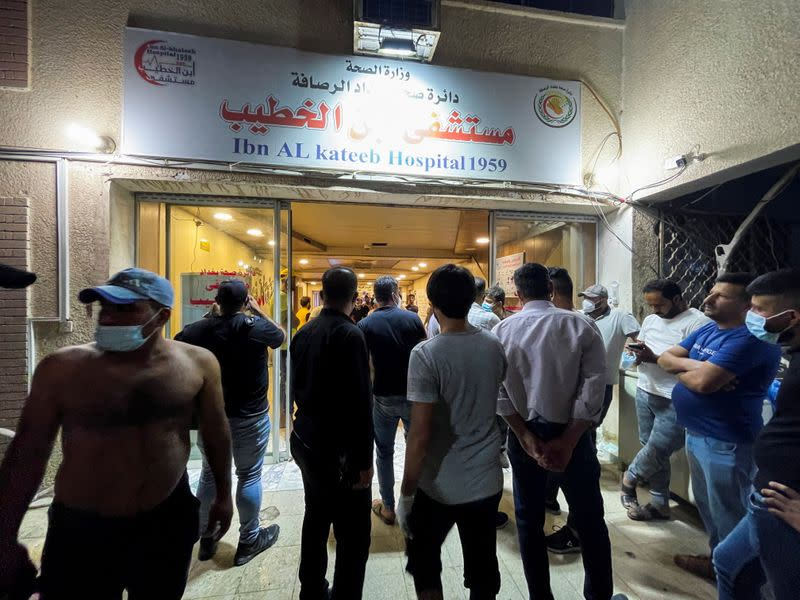 People gather at Ibn Khatib hospital after a fire caused by an oxygen tank explosion in Baghdad