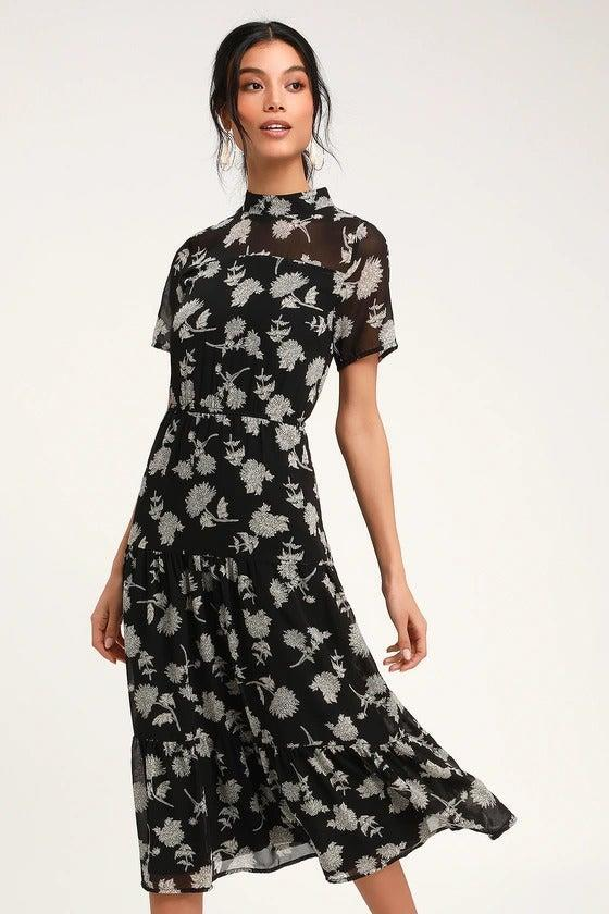 """<h2>Lulus Black Floral Print Midi Dress</h2><br>This California-based retailer is a must-visit for under-$100 fall frocks. No longer limited to matchy-matchy bridesmaids dresses, Lulus boats a reader-beloved selection of minis and maxis fit for everyday wear — in an inclusive size range that goes up to 3X in many styles (including this top-rated one).<br><br><strong>Lulus</strong> Black Floral Print Midi Dress, $, available at <a href=""""https://go.skimresources.com/?id=30283X879131&url=https%3A%2F%2Fwww.lulus.com%2Fproducts%2Ffloral-dressed-up-black-floral-print-midi-dress%2F751342.html"""" rel=""""nofollow noopener"""" target=""""_blank"""" data-ylk=""""slk:Lulus"""" class=""""link rapid-noclick-resp"""">Lulus</a>"""