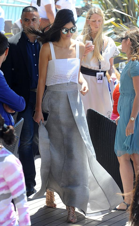 <p>Jenner's eyelet and linen outfit was the epitome of French Riviera chic. She paired her 3.1 Phillip Lim top with a flowing gray maxi skirt and mirrored sunglasses.</p>