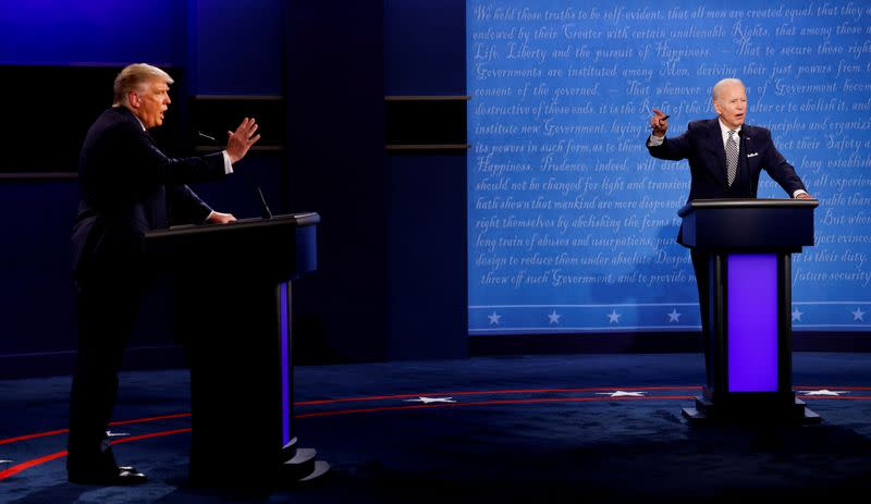 FILE PHOTO: FILE PHOTO: U.S. President Donald Trump and Democratic presidential nominee Joe Biden participate in their first 2020 presidential campaign debate in Cleveland