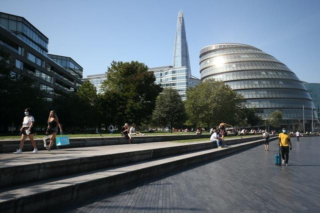 Lunch-time visitors observe social distancing rules as they enjoy the autumn sunshine in Potters Field Park, near City Hall, London