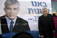 Israeli actor, journalist and author Yair Lapid, leader of the Yesh Atid party, visits a polling station in the coastal city of Netanya, on January 22, 2013