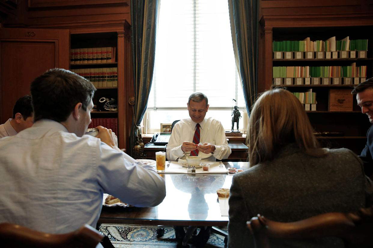 U.S. Chief Justice John Roberts eats a bowl of soup as he sits down to lunch with his team of clerks in his private study at the U.S. Supreme Court in Washington on June 15, 2016.