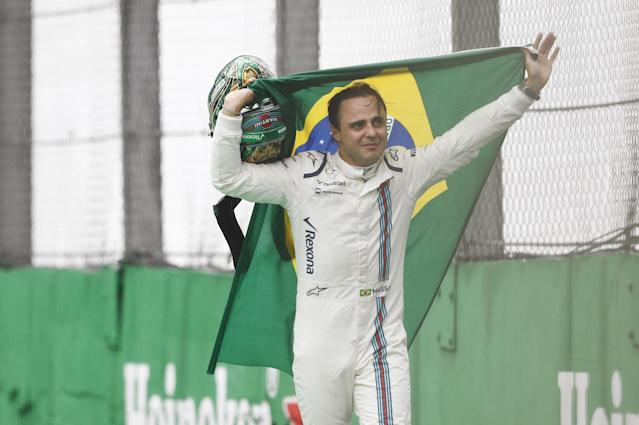 Seeya soon… real soon: Felipe Massa waves to F1 fans on his previous 'last' appearance at Interlagos, in 2016