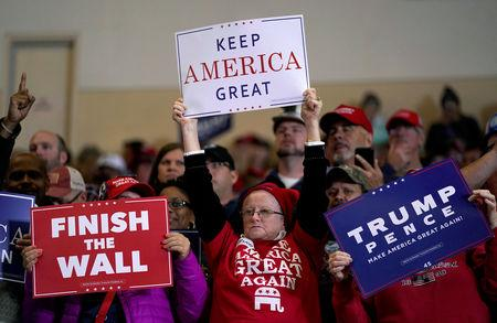 Supporters wave signs before U.S. President Donald Trump arrives to speak at a Make America Great Again rally in Richmond, Kentucky, U.S., October 13, 2018.      REUTERS/Joshua Roberts